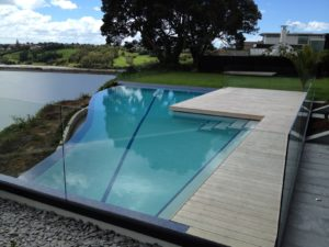 Cliff Edge Swimming Pool With Weir Edge