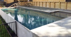 Half in ground half out of ground concrete pool