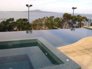 Raised Spa Pool With View Over Swimming Pool french grey hydrazzo