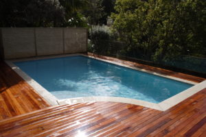 Remuera Plunge Swimming Pool with Natural Sandstone Coping Border in Timber Deck Surrounds