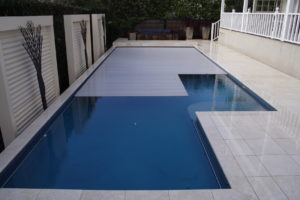 Remuera Swimming Pool with Fully Automatic in Ground Slatted Pool Cover System