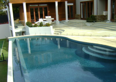 Weir Edge Swimming Pool with French Grey Hydrazzo Plaster