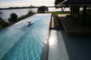 Weir Edge Concrete Pool with Water Feature Resevior