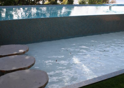 water feature with stepping stone access to main pool